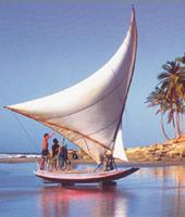 A sailing vessel spreading its wings on the shores near Fortaleza, Brazil